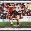A stamp printed in the Belize, is dedicated to FIFA World Cup 1982 in Spain, shows a match between Austria - Chile, circa 1982 — Stock Photo
