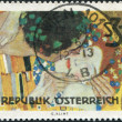 Постер, плакат: A stamp printed in Austria shows a picture of The Kiss by Gustav Klimt circa 1964