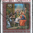 "A stamp printed in Austria, shows the icon of Christmas, ""Holy Family"" from the Church of St. Barbara, Ukrainian Greek Catholic Church, Vienna - Stock Photo"