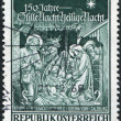 "Stock Photo: Stamp printed in Austria, devoted to 150th anniversary of Memorial Chapel, Oberndorf-Salzburg, is shown Hymn ""Silent Night, Holy Night"