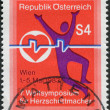 Royalty-Free Stock Photo: A stamp printed in Austria, devoted to the 7th World Pacemakers Symposium, shows the Emblem, circa 1983