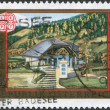 Stock Photo: Stamp printed in Austria, is shown Ebene Reichenau Post Office, circ1990