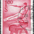 A stamp printed in Austria, shows a gymnast on Pommel horse, circa 1962 — Stock Photo