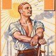 Poster printed in the Germany, shows a strong man against the background of plants and factories, publisher E. Braun & Co., Berlin, Germany — Stock Photo
