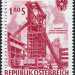 A stamp printed in Austria, devoted to 15th anniversary of nationalized industry, shows a montage Iron blast furnace, circa 1961 — Stock Photo