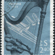 A stamp printed in the Austrian, is dedicated to World tour of the Vienna Philharmonic Orchestra, shows the Orchestral Instruments, circa 1959 - Stock Photo