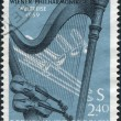 Stock Photo: Stamp printed in Austrian, is dedicated to World tour of ViennPhilharmonic Orchestra, shows Orchestral Instruments, circ1959