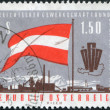 A stamp printed in Austria, devoted to the 5th Congress of the Austrian Trade Union Federation, shows a flag, emblem, map, factory, circa 1963 - Stock Photo