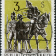 A stamp printed in Austria, devoted to the First International Postal Conference, Paris, shows Postilions and Postal Clerk, circa 1963 - 图库照片