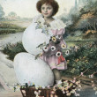Stock Photo: Vintage postcard, shows girl in basket and Easter eggs, circ1917
