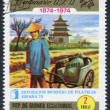 A stamp printed in the Equatorial Guinea, is devoted to the philately exhibition in Spain-75, shows the Chinese postman, circa 1974 — Stock Photo