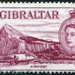 GIBRALTAR - CIRCA 1953: A stamp printed in the Gibraltar, shows the aircraft and the airport, circa 1963 — Stok fotoğraf