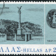 图库照片: GREECE - CIRC1971: stamp printed in Greece, is dedicated to 150th anniversary of national uprising, shows Memorial column, provincial administrative