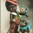 Germany in 1928. The old mail greeting card. The black boy with a cat and flowers. German Text: Happy Birthday! — Stock Photo #12086727
