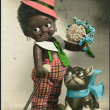 Germany in 1928. The old mail greeting card. The black boy with a cat and flowers. German Text: Happy Birthday! — 图库照片