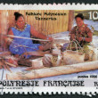 Stock Photo: FRENCH POLYNESIA - CIRCA 1986: Postage stamps printed in French Polynesia, depicts a woman weaving a basket weaving, circa 1986