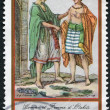 Stock Photo: FRENCH POLYNESIA - CIRCA 1985: Postage stamps printed in French Polynesia, depicts a man and a woman from Otahiti in national costumes, circa 1985