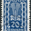 AUSTRIA - CIRCA 1922: A stamp printed in Austria, shows Symbols of Agriculture, circa 1922 - Stock Photo