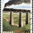 GREECE - CIRCA 1984: Postage stamps printed in Greece, is dedicated to the 100th anniversary of railways in Greece, shows steam locomotive on the Papadia Bridge - Stock Photo