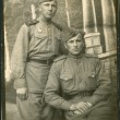 USSR - CIRCA 1945: Photo taken in the USSR, depicted soldiers and an officer of the Red Army, circa 1945 - Stock Photo