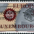 Royalty-Free Stock Photo: LUXEMBOURG - CIRCA 1967: A stamp printed in Luxembourg, shows Cogwheels and emblem CEPT, circa 1967