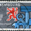 Stock Photo: LUXEMBOURG - CIRC1960: stamp printed in Luxembourg, is dedicated to National Exhibition of Craftsmanship, Luxembourg-Limpertsberg, shows Heraldic Lion
