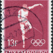 LUXEMBOURG - CIRCA 1968: A stamp printed in Luxembourg, is dedicated to summer Olympic Games in Mexico, is shown Fencing, circa 1968 - Stock Photo