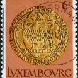 LUXEMBOURG - CIRCA 1980: A stamp printed in Luxembourg, shows gold coin of the time of Wenzel von Luxemburg, Easter lamb, circa 1980 - Stock Photo