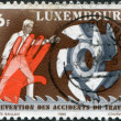 Stock Photo: LUXEMBOURG - CIRC1980: stamp printed in Luxembourg, is dedicated to 9th World Congress on Prevention of Occupational Accidents & Diseases, Amsterdam, shows Man