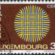 Royalty-Free Stock Photo: LUXEMBOURG - CIRCA 1970: A stamp printed in Luxembourg, shows Interwoven Threads, circa 1970