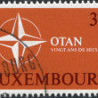 LUXEMBOURG - CIRCA 1969: A stamp printed in Luxembourg, is dedicated to 20th anniversary of the North Atlantic Treaty Organization or NATO, shows the symbol NATO — Stock Photo #12086931