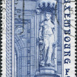 图库照片: LUXEMBOURG - CIRC1980: stamp printed in Luxembourg, Goddess of Fertility - Ceres by JeMich, sculpture in front of main entrance to State Savings Bank