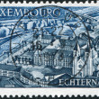 LUXEMBOURG - CIRCA 1969: A stamp printed in Luxembourg, shows St. Willibrord's Basilica and Abbey, Echternach, circa 1969 — Stock Photo
