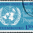 LUXEMBOURG - CIRCA 1970: A stamp printed in Luxembourg, is dedicated to 25th anniversary of the United Nations, shows UN Emblem, circa 1970 — Stock Photo