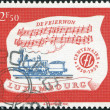 Stock Photo: LUXEMBOURG - CIRC1959: stamp printed in Luxembourg, is dedicated to Centenary of Luxembourg's railroads, shows Locomotive A1n2 of 1859 and Hymn, circ1959