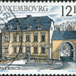 LUXEMBOURG - CIRCA 1987: A stamp printed in Luxembourg, shows Health Center, 18th century, Mersch, circa 1987 — Stock Photo