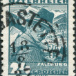 Stock Photo: AUSTRI- CIRC1934: stamp printed in Austria, shows woodcutter, Mount Kitzsteinhorn, Zeller See (Salzburg), circ1934