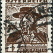 Royalty-Free Stock Photo: AUSTRIA - CIRCA 1934: A stamp printed in Austria, shows a farmer from Traunkreis, Lake Traunsee and Schloss Ort, circa 1934