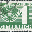 Stock Photo: AUSTRI- CIRC1935: stamp printed in Austria, shows new coat of arms, bicapital eagle, circ1935