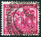 A stamp printed in India, shows a family of refugees (a series of stamps to help the refugees from East Pakistan), circa 1971 — Stock Photo
