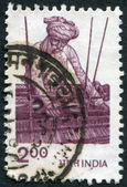 A stamp printed in India, shows a man for weaving, circa 1983 — Stock Photo