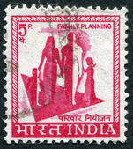 A stamp printed in India, shows a symbol of family planning campaign, circa 1976 — Stock Photo