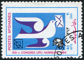 A stamp printed in the Afghanistan devoted to 19th UPU Congress, Hamburg. Shows a pigeon with a letter, circa 1984 — Stock Photo