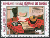 "A stamp printed in the Comoros, shows a painting by Pablo Picasso ""The Red Tablecloth"", circa 1981 Ключевые слова:brand, collection, collector, communication, — Stock Photo"