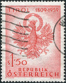 A stamp printed in Austria, devoted to 150th anniversary of the Fight for liberation of Tyrol, shows the Coat of Arms, Tyrol, circa 1959 — Stock Photo