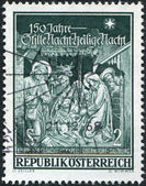 """A stamp printed in Austria, devoted to 150th anniversary of the Memorial Chapel, Oberndorf-Salzburg, is shown Hymn """"Silent Night, Holy Night — Stock Photo"""