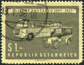 A stamp printed in Austria, shows the Old and New Postal Motor Coach, circa 1957 — Stock Photo