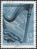 A stamp printed in the Austrian, is dedicated to World tour of the Vienna Philharmonic Orchestra, shows the Orchestral Instruments, circa 1959 — Stock Photo