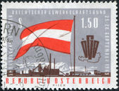 A stamp printed in Austria, devoted to the 5th Congress of the Austrian Trade Union Federation, shows a flag, emblem, map, factory, circa 1963 — Stock Photo