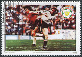 A stamp printed in the Belize, is dedicated to FIFA World Cup 1982 in Spain, shows a match between Austria - Chile, circa 1982 — Стоковое фото
